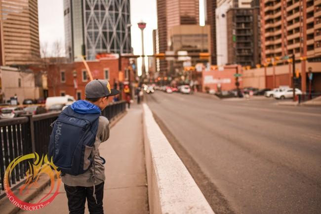 Tobi framing a shot of Calgary Tower